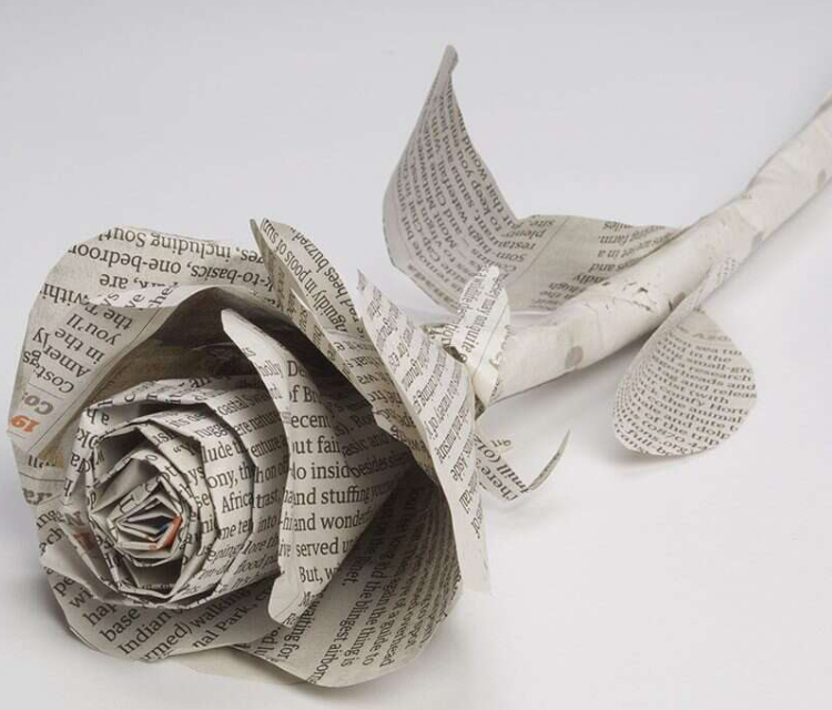 Newspaper Rose Placed On The Table.