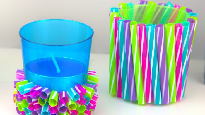 Two Little Holders With Colorful Straws.