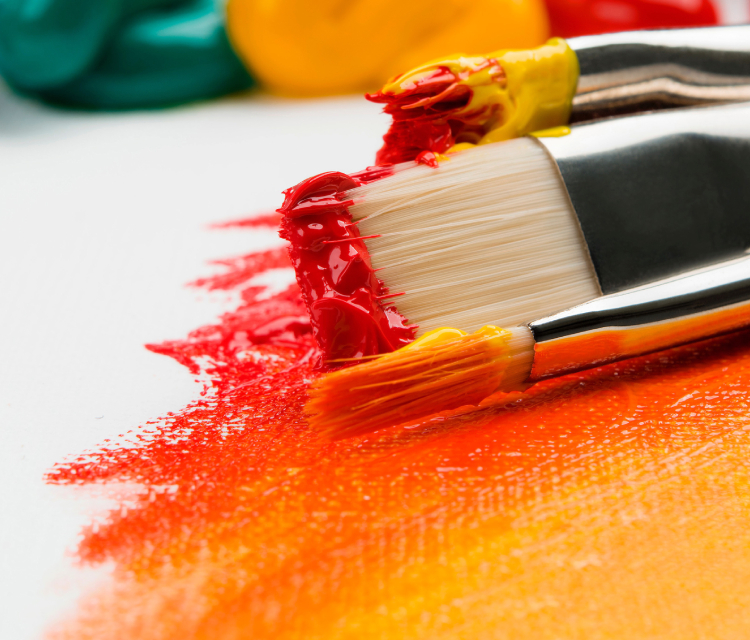 An Orange Colored Paint And Brush.