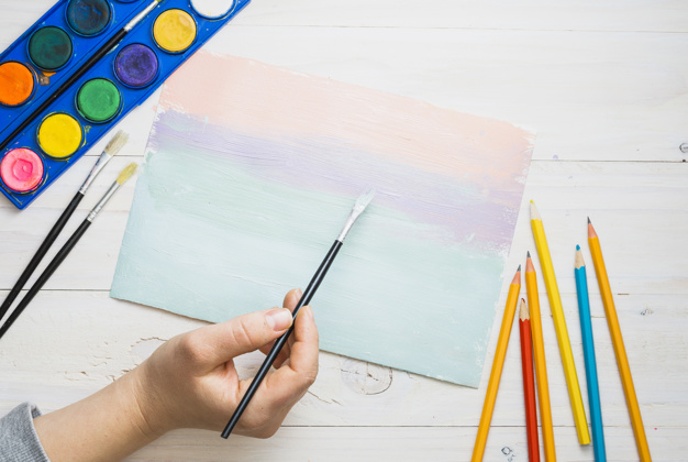 A Kid's Hand Hold The Painting Brush & Give The Color Shade Of Water.